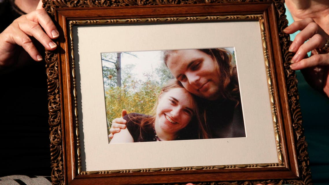 Mother's Linda Boyle, left and Lyn Coleman hold photo of their married children, Joshua Boyle and Caitlan Coleman, who were kidnapped by the Taliban in late 2012, Wednesday, June 4, 2014. ap