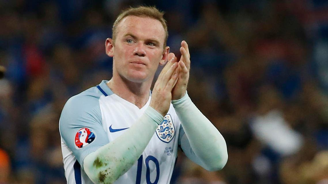 England's Wayne Rooney applauds the fans at the end of the game REUTERS