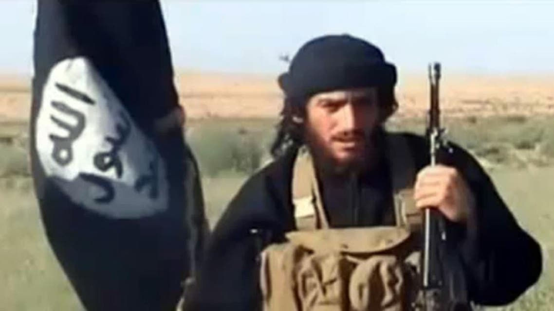 This file image shows an image grab taken on October 2, 2013 from a video uploaded on YouTube on July 8, 2012, of the spokesman for the Islamic State of Iraq and the Levant (ISIS), Abu Mohammad al-Adnani al-Shami, speaking next to an Islamist flag at an undisclosed location. AFP