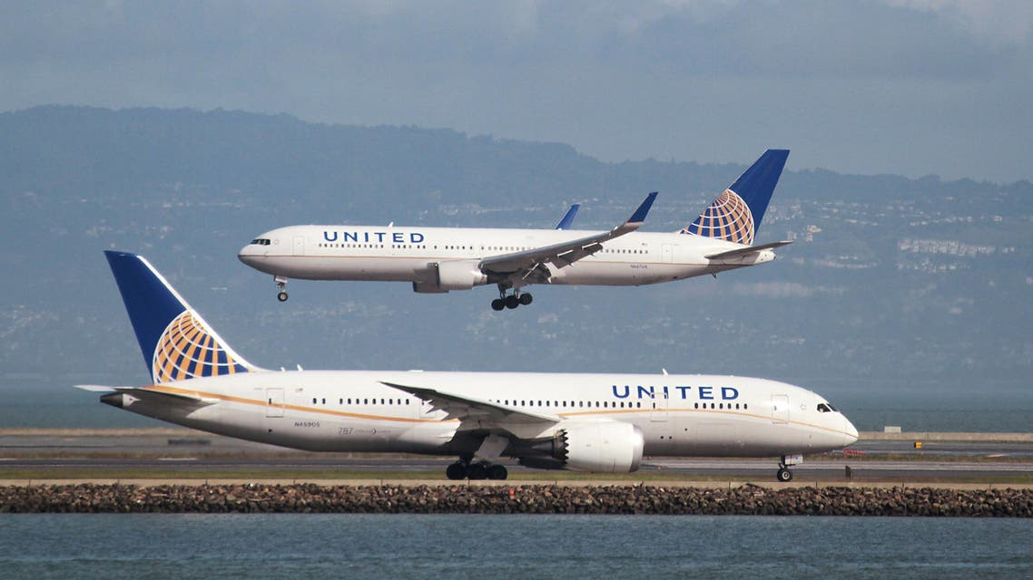A United Airlines Boeing 787 taxis as a United Airlines Boeing 767 lands at San Francisco International Airport, San Francisco, California, February 7, 2015. REUTERS