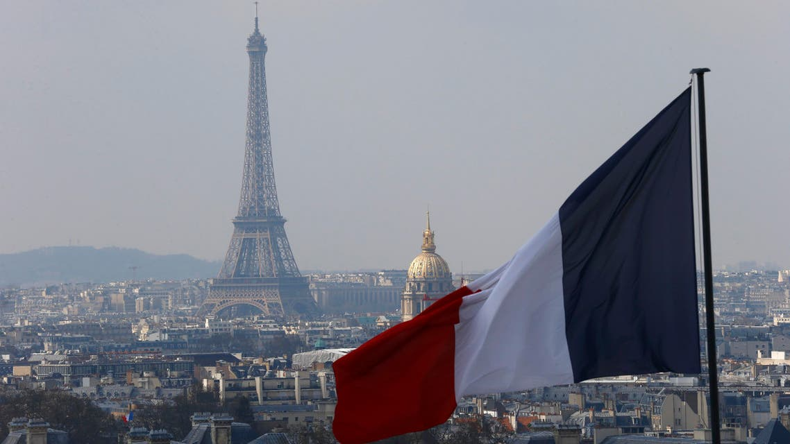 The French flag above the skyline of the French capital with the Eiffel Tower, The Invalides Dome and roof tops are seen from the colonnade of the Pantheon Dome in Paris, France, Friday, April 1, 2016. (Photo: AP)