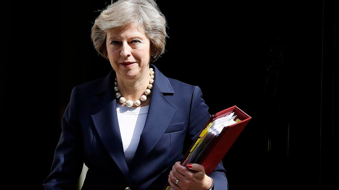 """In this Wednesday, July 20, 2016 file photo, Britain's Prime Minister Theresa May leaves 10 Downing street to attend her first Prime Ministers Questions at the House of Parliament in London. Prime Minister Theresa May is attempting to allay disquiet about her surprise delay to a Chinese-backed nuclear power plant by reassuring China's leader that Britain wants strong relations with Beijing. Foreign Office Minister Alok Sharma delivered a letter from May to President Xi Jinping during a visit to Beijing. May's office did not publish the letter, but said Tuesday, Aug. 16 it was about """"reassuring the Chinese of our commitment to Anglo-Chinese relations."""" (AP Photo/Frank Augstein, file)"""