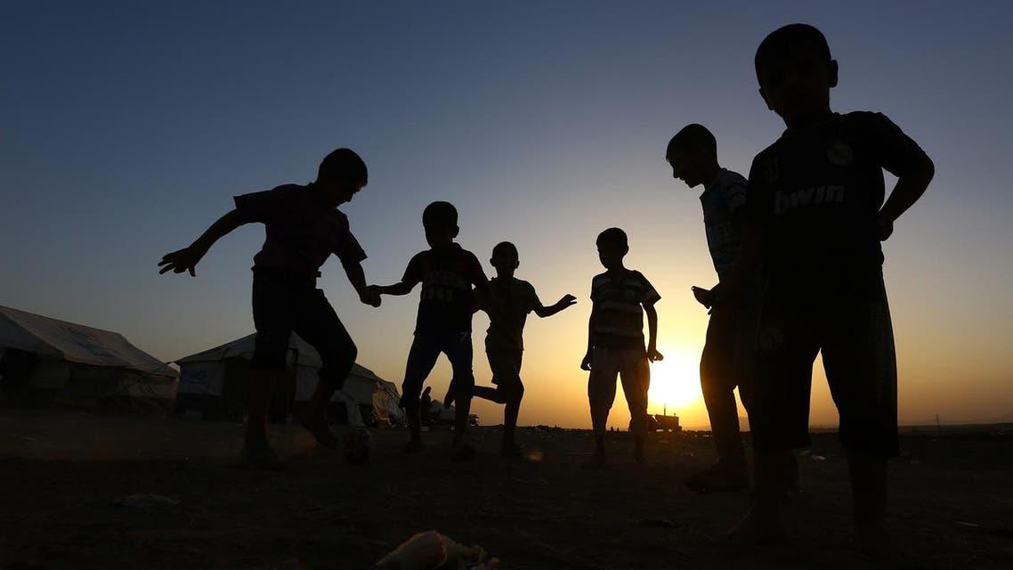 Children play football at Khazir refugee camp outside Irbil north Iraq. (AP)