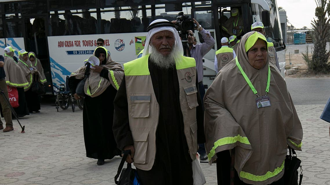 Palestinian Muslim pilgrims arrive at the Rafah border crossing between Egypt and the southern Gaza Strip, on August 30, 2016 ahead of their departure to the annual Hajj pilgrimage in Saudi Arabia's holy city of Mecca. SAID KHATIB / AFP
