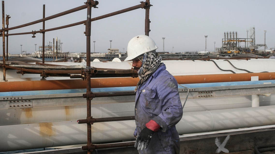 An Iranian man works at an oil facility in the Khark Island, on the shore of the Gulf, on February 23, 2016.