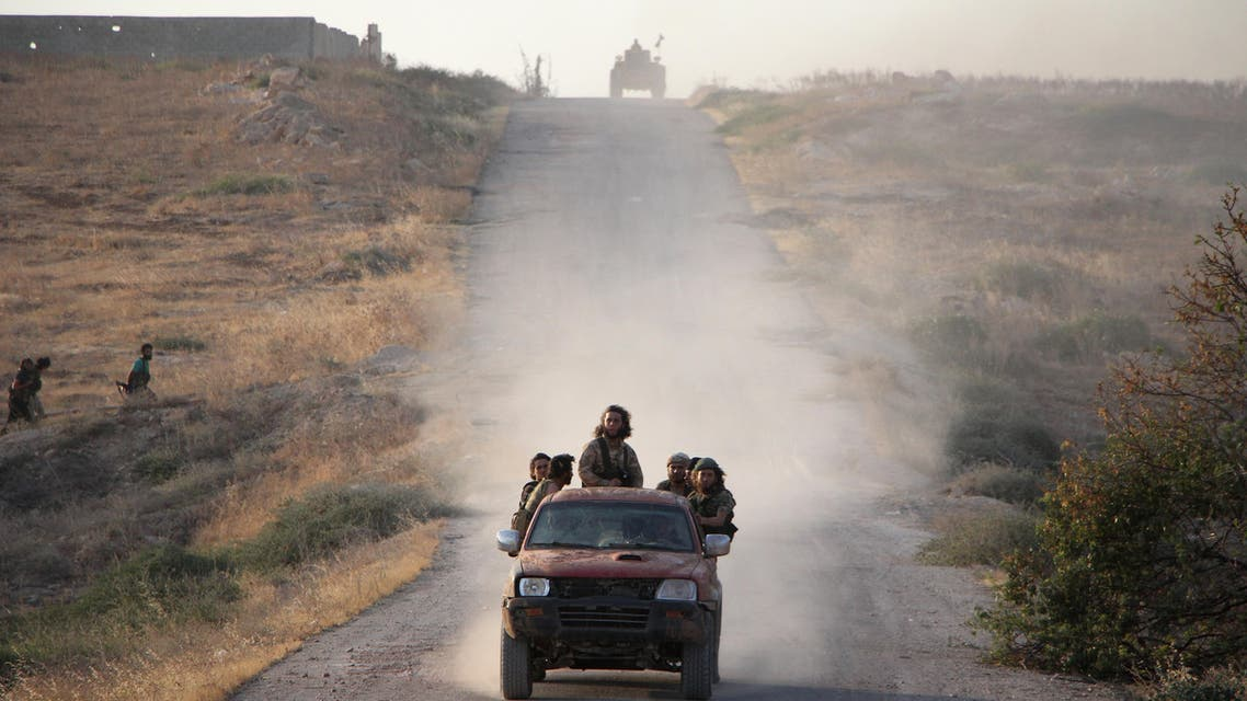 Fighters from the Jund al-Aqsa Islamist Brigade drive towards the northern Syrian town of Tayyibat al-Imam, northwest of Hama on August 31, 2016, after taking control of the town from Syrian government forces. Omar haj kadour / AFP