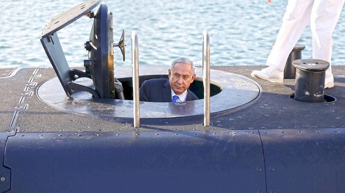 sraeli Prime Minister Benjamin Netanyahu climbs out after a visit inside the Rahav, the fifth submarine in the fleet, after it arrived in Haifa port January 12, 2016. (Reuters)