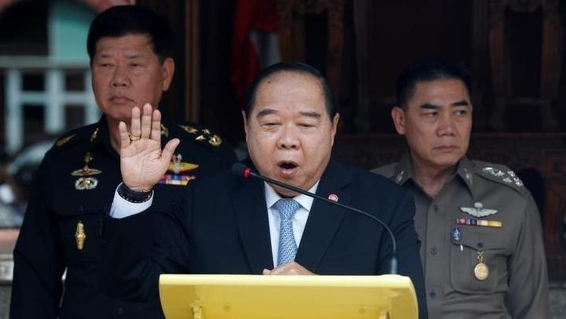 Thailand's Deputy Prime Minister and Defence Minister Prawit Wongsuwan (C) speaks during a news conference after a National Security Council meeting as Thailand's national police chief Jakthip Chaijinda (R) and The Commander-in-Chief of the Royal Thai Army, Teerachai... REUTERS/Chaiwat Subprasom