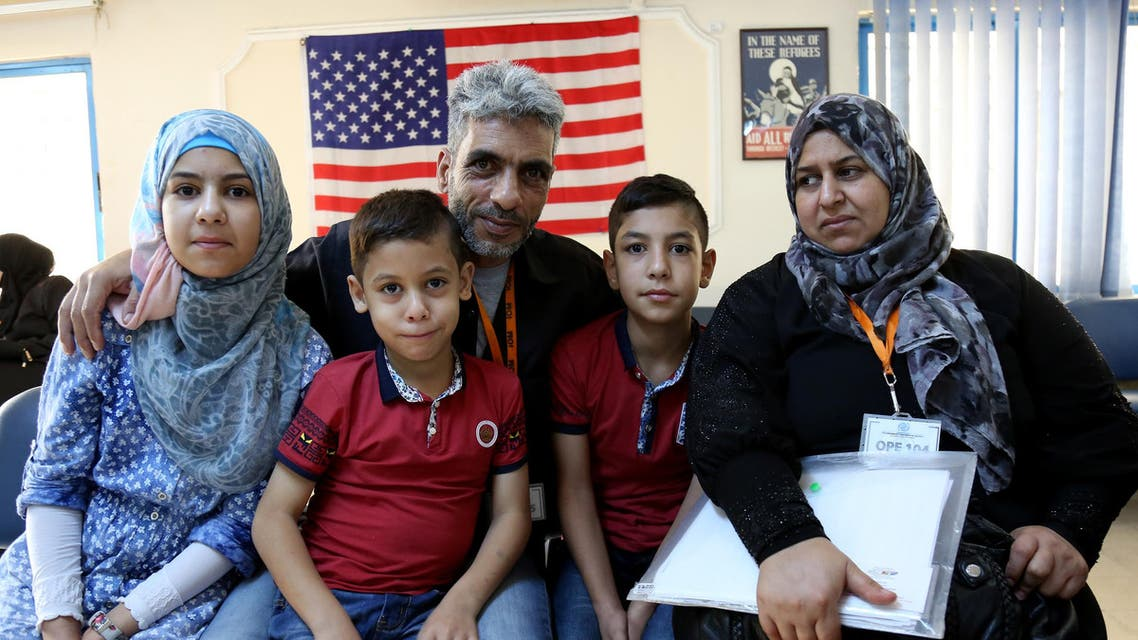 In this photo taken Sunday, August 28, 2016, five members of the Jouriyeh family, Syrian refugees headed to the U.S. as part of a resettlement program, post for a photo in the Amman, Jordan office of the International Organization for Migration. AP