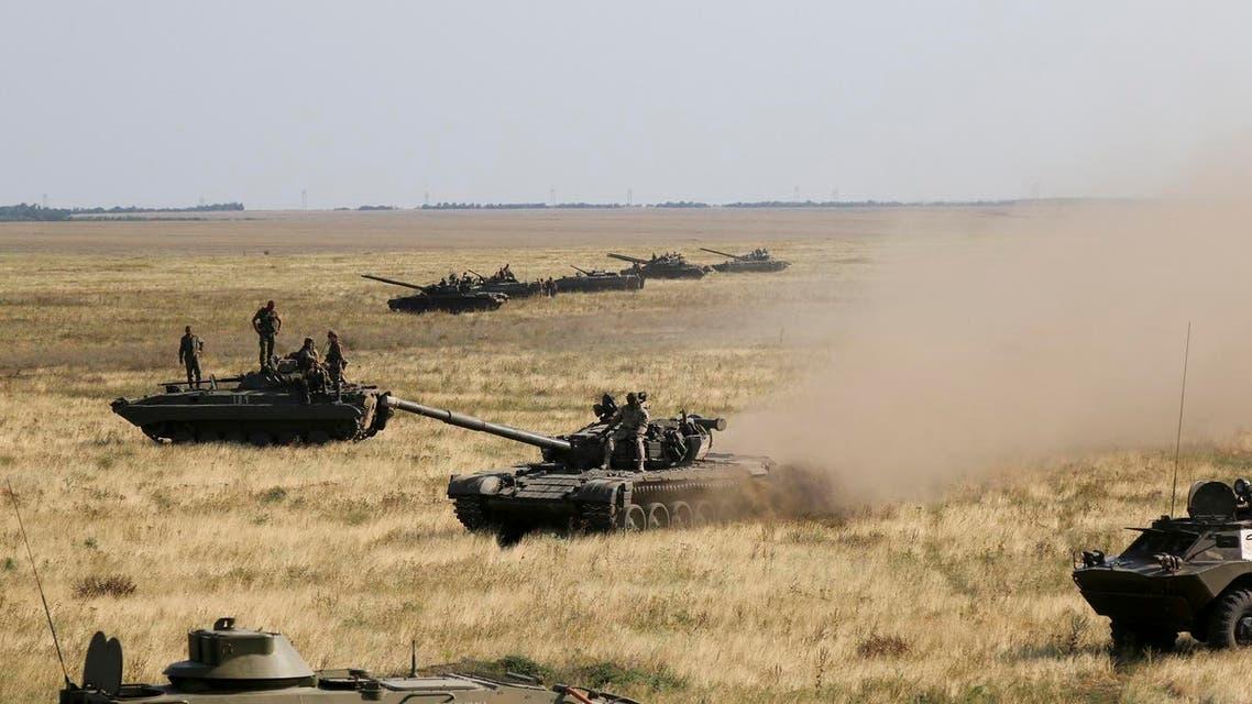Ukrainian tanks and APCs move towards the de-facto border with Crimea near Kherson, southern Ukraine, Friday, Aug. 12, 2016. (AP)