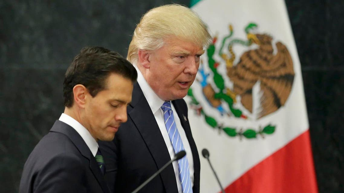 U.S. Republican presidential nominee Donald Trump and Mexico's President Enrique Pena Nieto arrive for a press conference at the Los Pinos residence in Mexico City. (Reuters)