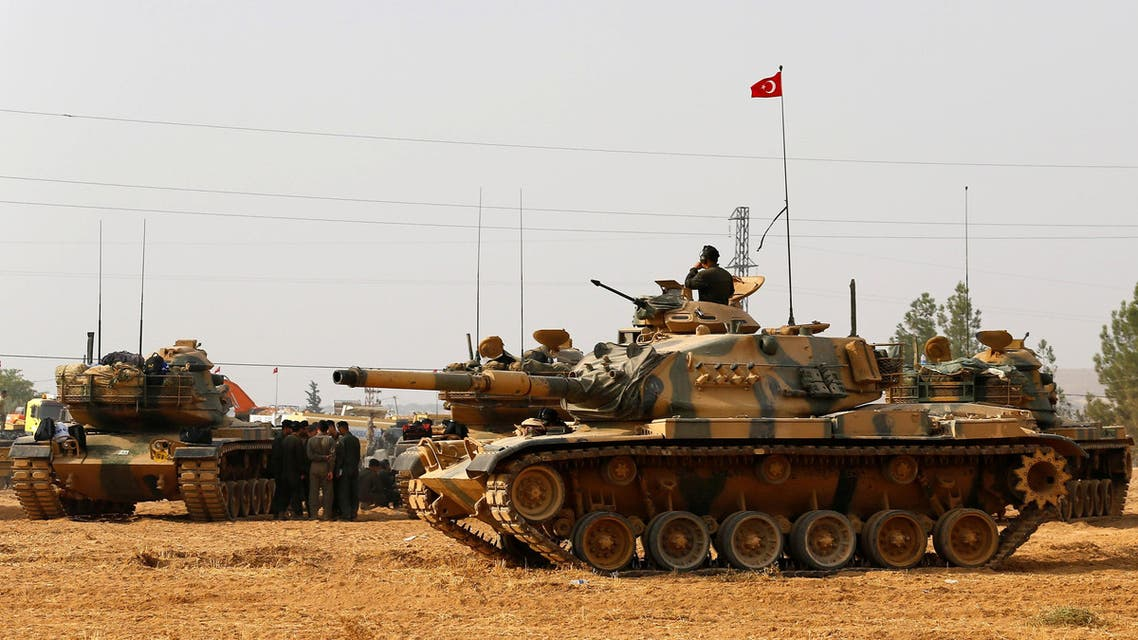 Turkish army tanks and military personal are stationed in Karkamis on the Turkish-Syrian border in the southeastern Gaziantep province, Turkey, August 25, 2016. reuters