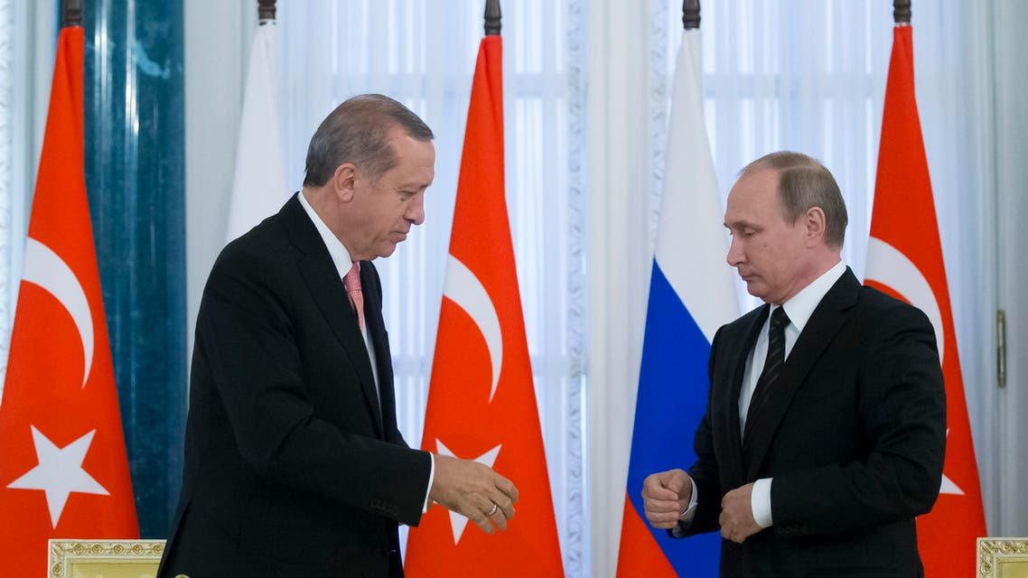 Russian President Vladimir Putin, right, and Turkish President Recep Tayyip Erdogan shake hands during a news conference after their talks in the Konstantin palace outside St. Petersburg, Russia, on Tuesday, Aug. 9, 2016. (Reuters)