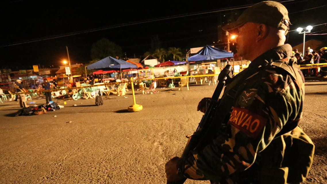 A Philippine soldier keeps watch at a blast site at a night market that has left several people dead and wounded others in southern Davao city, Philippines late Friday Sept. 2, 2016. (AP)