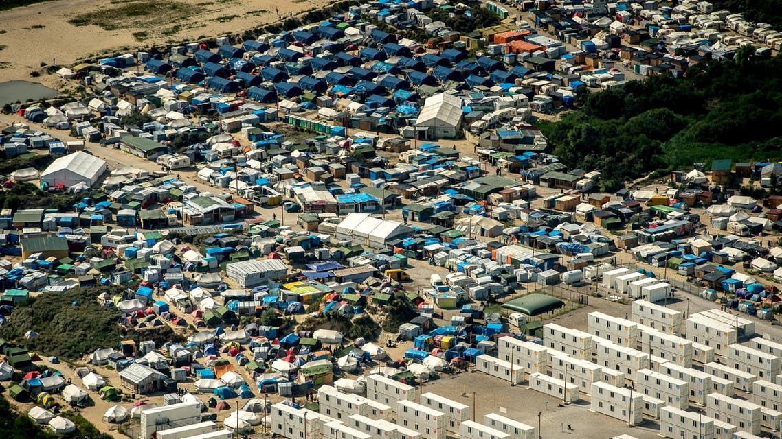 """This file photo taken on August 16, 2016 shows an aerial view of tents in the """"jungle"""" camp in Calais, northern France. (AFP)"""