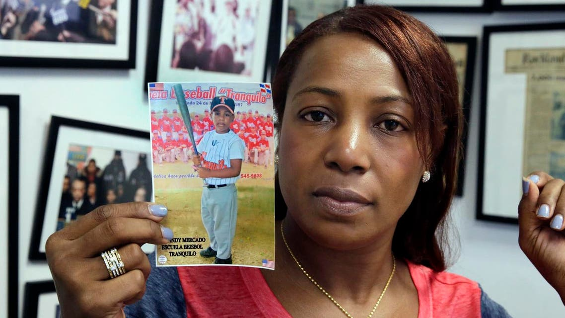Maribel Martinez holds a photo of her son Andy at her attorney's office, in the Brooklyn borough of New York, Thursday, Sept. 1, 2016. (AP)