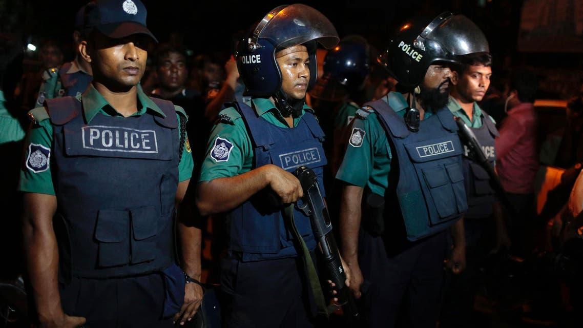 Bangladeshi policemen keep vigil at the scene of a raid on a suspected militant hideout in Dhaka, Bangladesh, Friday, Sept. 2, 2016. (AP)