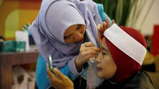 Consumer giants court Muslims with halal face creams, shampoos