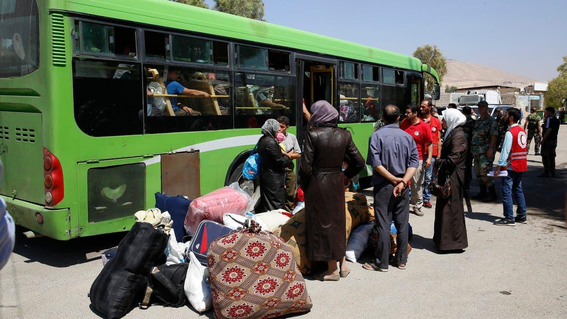 Dozens of Syrians evacuate besieged suburb of Damascus