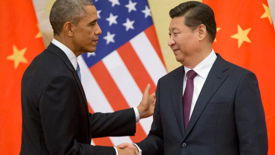 In this Nov. 12, 2014 file photo, President Barack Obama shakes hands with Chinese President Xi Jinping at the conclusion of their joint news conference at the Great Hall of the People in Beijing. (AP)