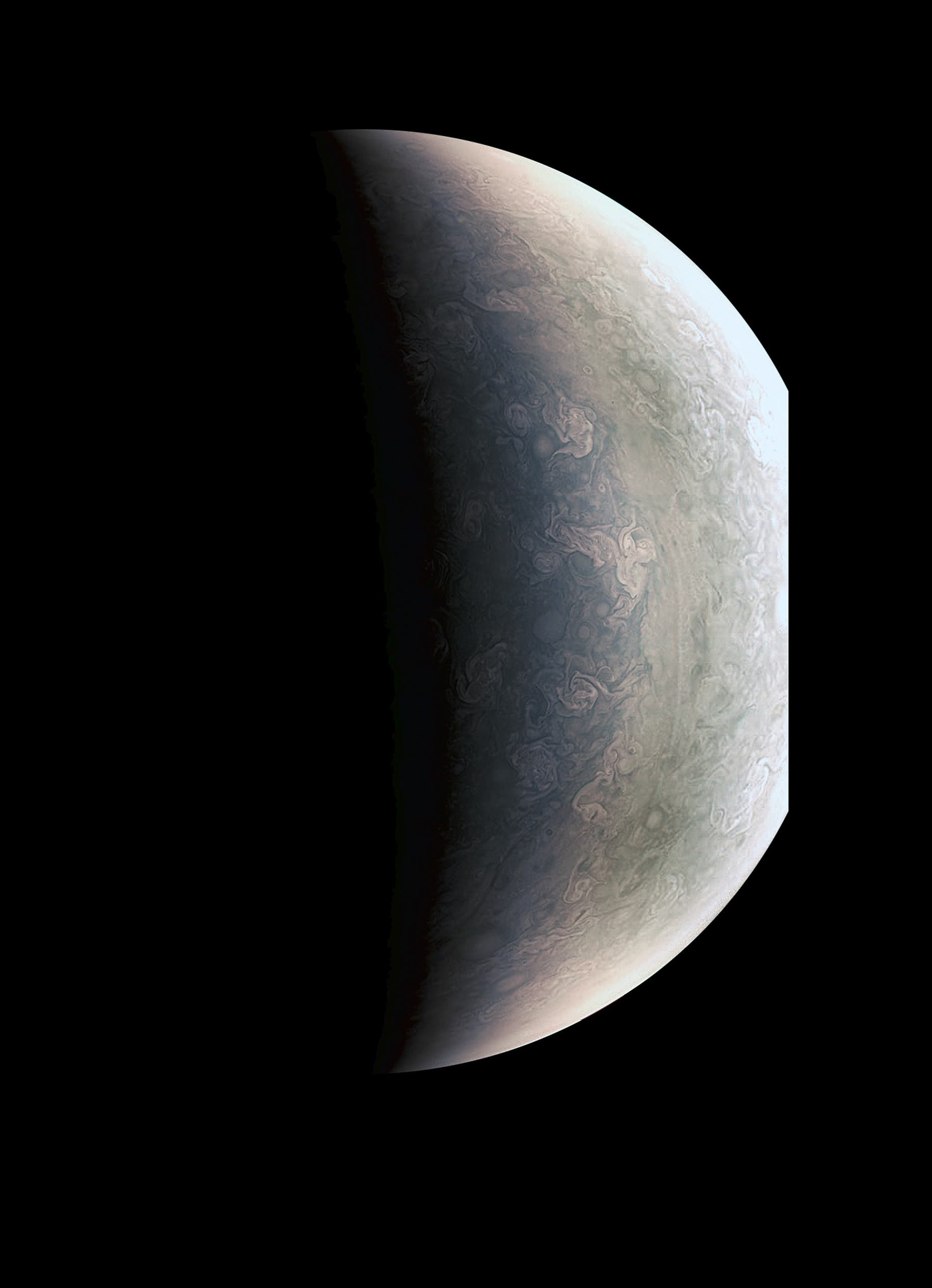 This image from NASA's Juno spacecraft provides a never-before-seen perspective on Jupiter's south pole. The JunoCam instrument acquired the view on August 27, 2016, when the spacecraft was about 58,700 miles (94,500 kilometers) above the polar region. At this point, the spacecraft was about an hour past its closest approach, and fine detail in the south polar region is clearly resolved.  HO / NASA / AFP