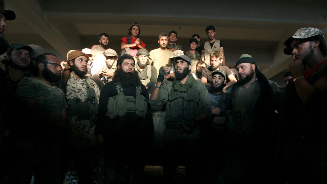 Rebel fighters gather in an artillery academy of Aleppo, Syria, August 6, 2016. REUTERS/Ammar Abdullah