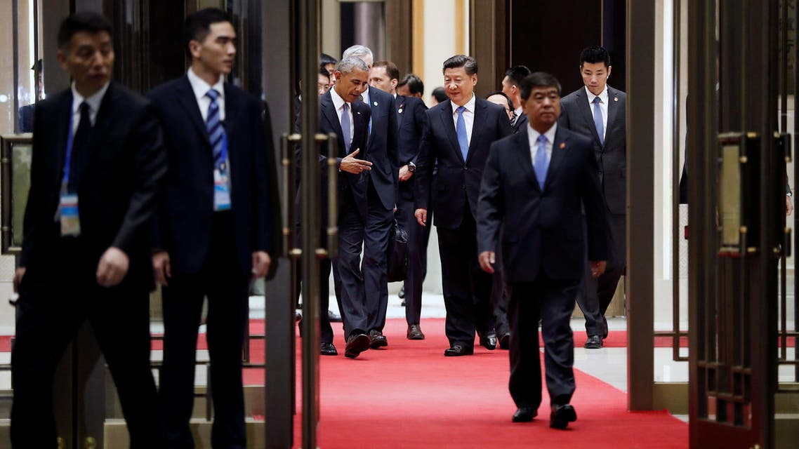 U.S. President Barack Obama and Chinese President Xi Jinping walk to the door to take a stroll outside at West Lake State Guest House in Hangzhou, in eastern China's Zhejiang province, September 3, 2016. REUTERS