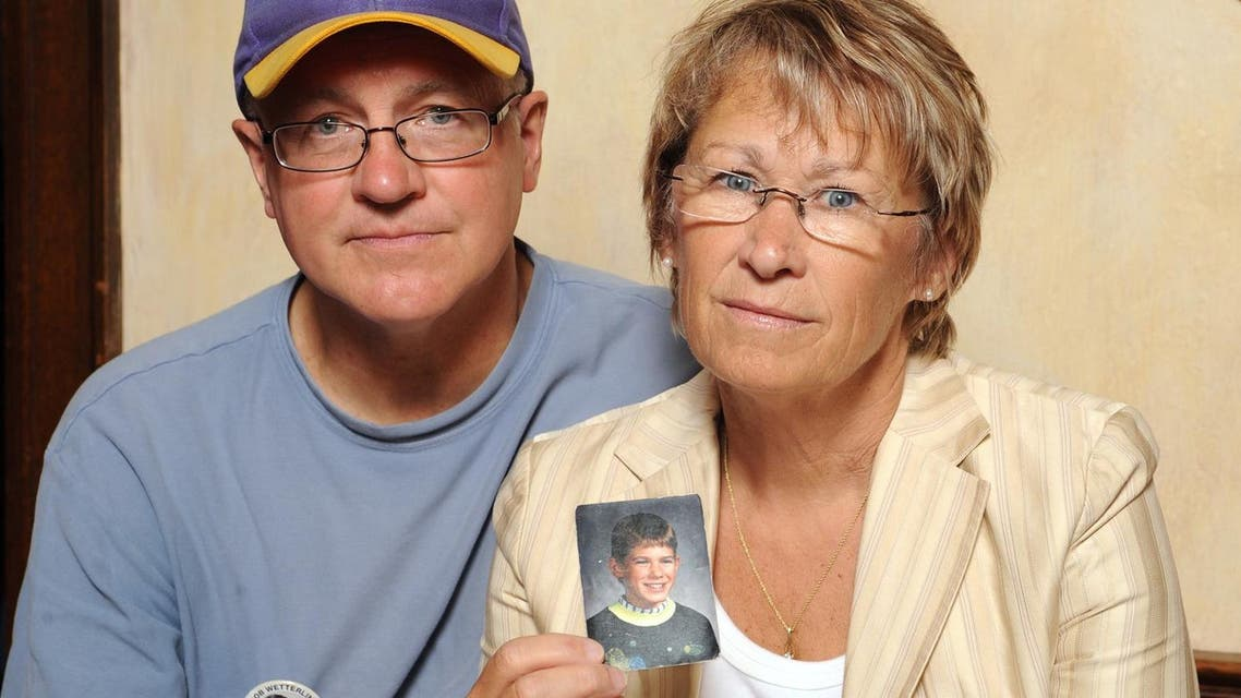 In this Aug. 28, 2009, file photo, Patty and Jerry Wetterling show a photo of their son Jacob Wetterling, who was abducted in October of 1989 in St. Joseph, Minneapolis. (File Photo: AP /Craig Lassig)