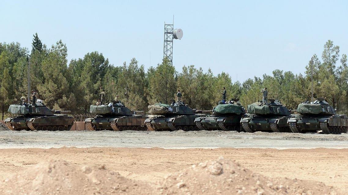 Turkish tanks stationed near the Syrian border, in Karkamis, Turkey, Saturday, Sept. 3, 2016 (Photo: Ismail Coskun, IHA via AP)