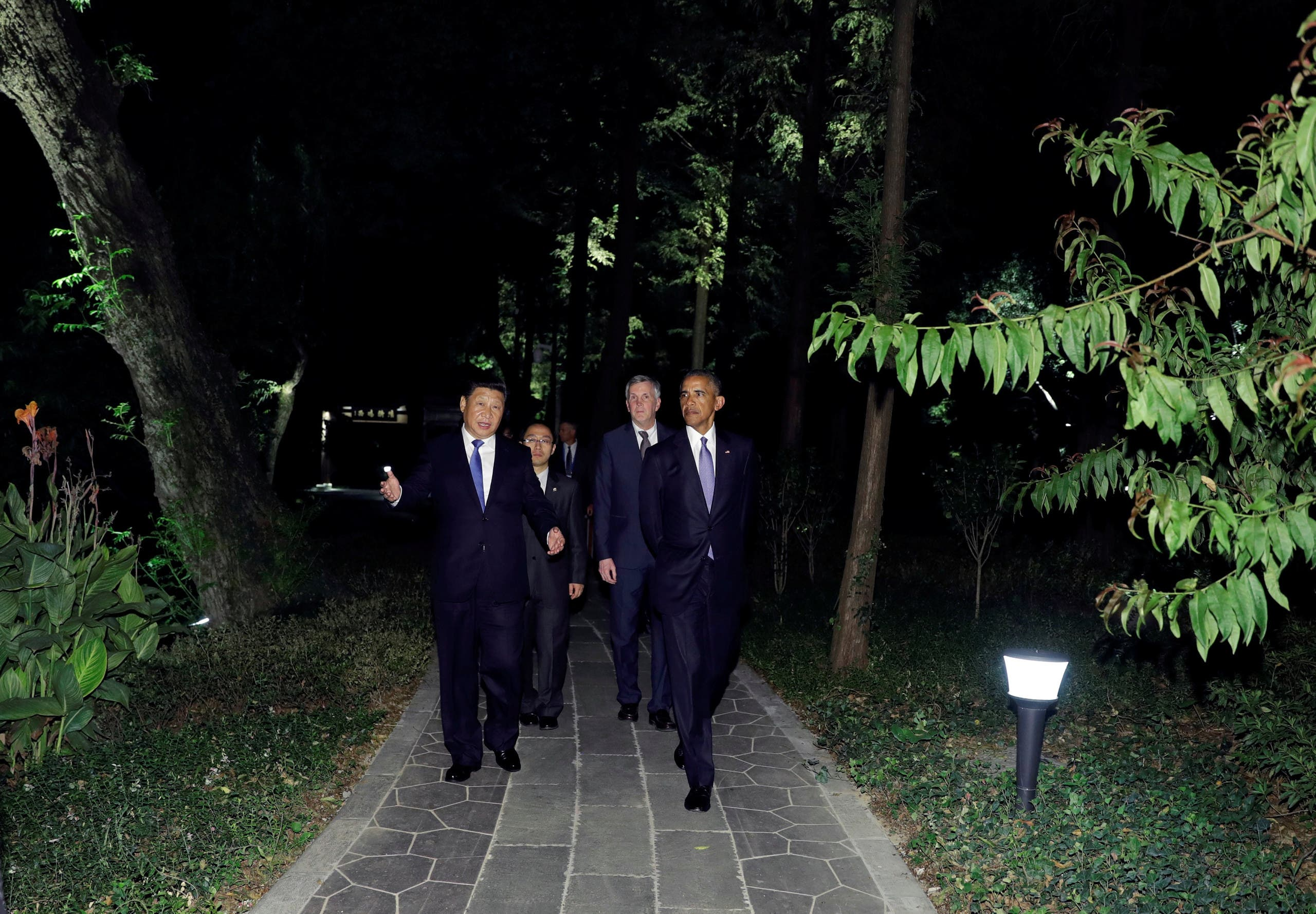 U.S. President Barack Obama and Chinese President Xi Jinping walk together at West Lake State Guest House in Hangzhou, in eastern China's Zhejiang province, September 3, 2016. REUTERS