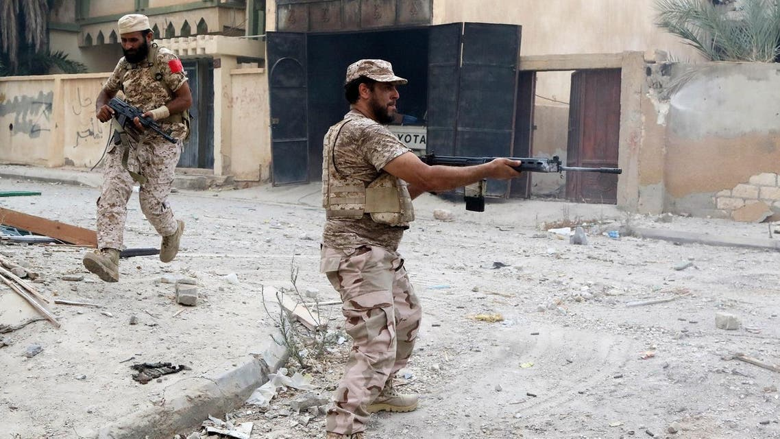 A member of the forces loyal to Libya's UN-backed Government of National Accord (GNA) lays down cover fire as a fellow member runs, in the coastal city of Sirte, during their military operation to clear ISIS from the city (File Photo: Mahmud Turkia/AFP)