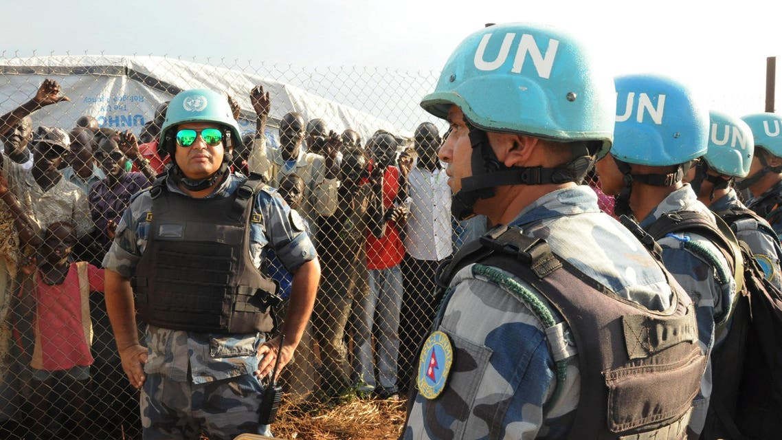 U.N. peacekeepers stand guard at a demonstration by people displaced in the recent fighting, during a visit by the United Nations Security Council, delegation to the UN House in Jebel, near South Sudan's capital Juba, September 3, 2016. REUTERS