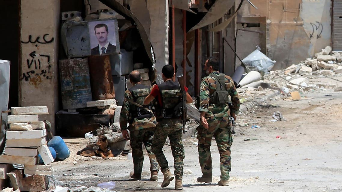 Syrian army soldiers patrol in government-controlled Aleppo's al-Khalidiya area where the army progressed towards the industrial zone of al-Layramoun and Bani Zeid on June 28, 2016. AFP