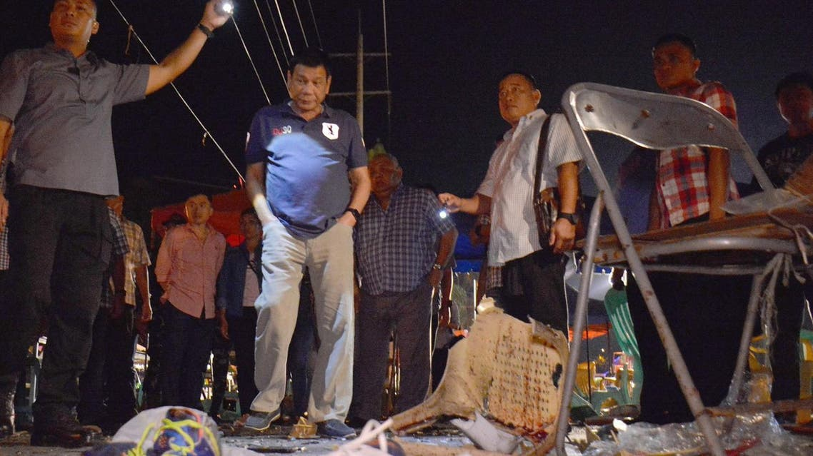 Philippine President Rodrigo Duterte, second left, visits the site of Friday night's explosion that killed more than a dozen people and wounded several others at a night market in Davao city, his hometown, Saturday, Sept. 3, 2016 in southern Philippines (Photo: Robinson Ninal/Malacanang Palace Presidential Communications Operations Office Presidential Photographers Division via AP)