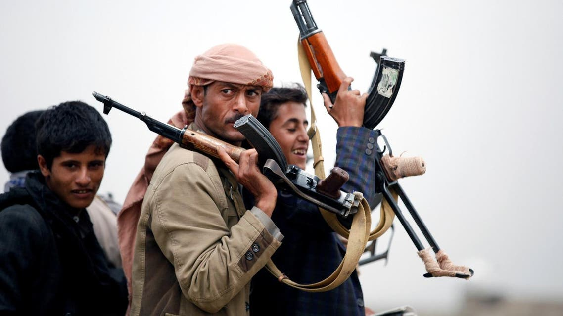 Tribesmen loyal to the Houthi movement ride on the back of a truck as they leave a tribal gathering in Sanaa. (Reuters)