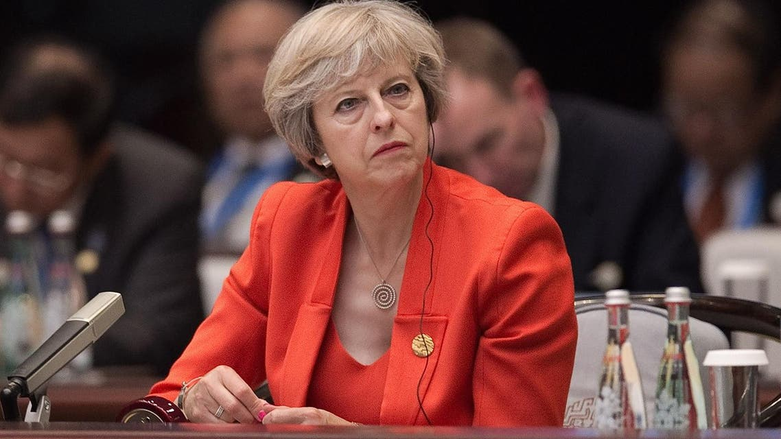 Britain's Prime Minister Theresa May listens to Chinese President Xi Jinping's speech during the opening ceremony of the G20 Leaders Summit in Hangzhou Sunday, Sept. 4, 2016. (Nicolas Asfouri/Pool Photo via AP)