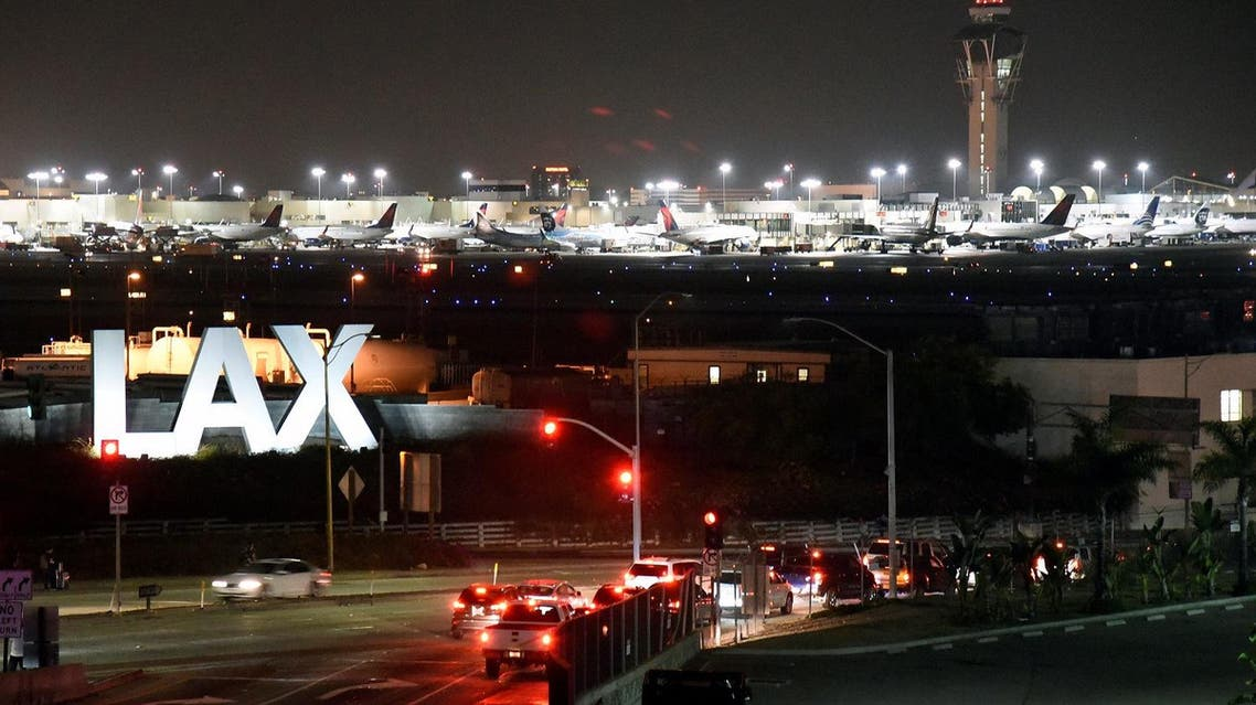 Traffic is seen near the LAX sign in Los Angeles. (Reuters)
