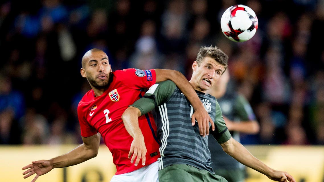 Germany's Thomas Muller (R) and Haitam Aleesami in action during their match in Oslo. REUTERS