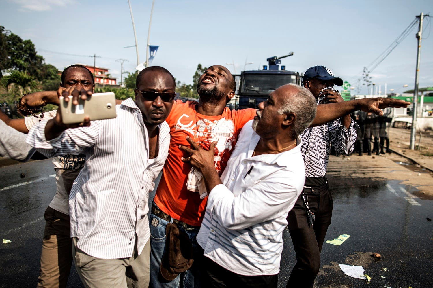 A distressed supporter of Gabonese opposition leader Jean Ping is carried away as protestors clash with anti riot policemen in Libreville on August 31, 2016 afp