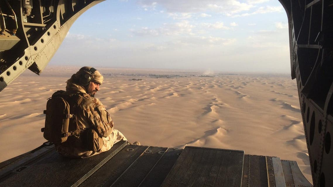 An Emirati gunner watches for enemy fire from the rear gate of a UAE Chinook military helicopter flying over Yemen (File Photo: AP)