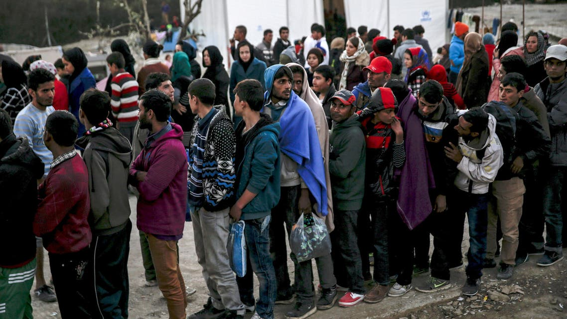 Refugees and migrants line up for a food distribution at the Moria refugee camp on the Greek island of Lesbos, November 5, 2015. REUTERS