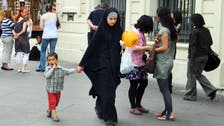 French school bars veiled Muslim mothers