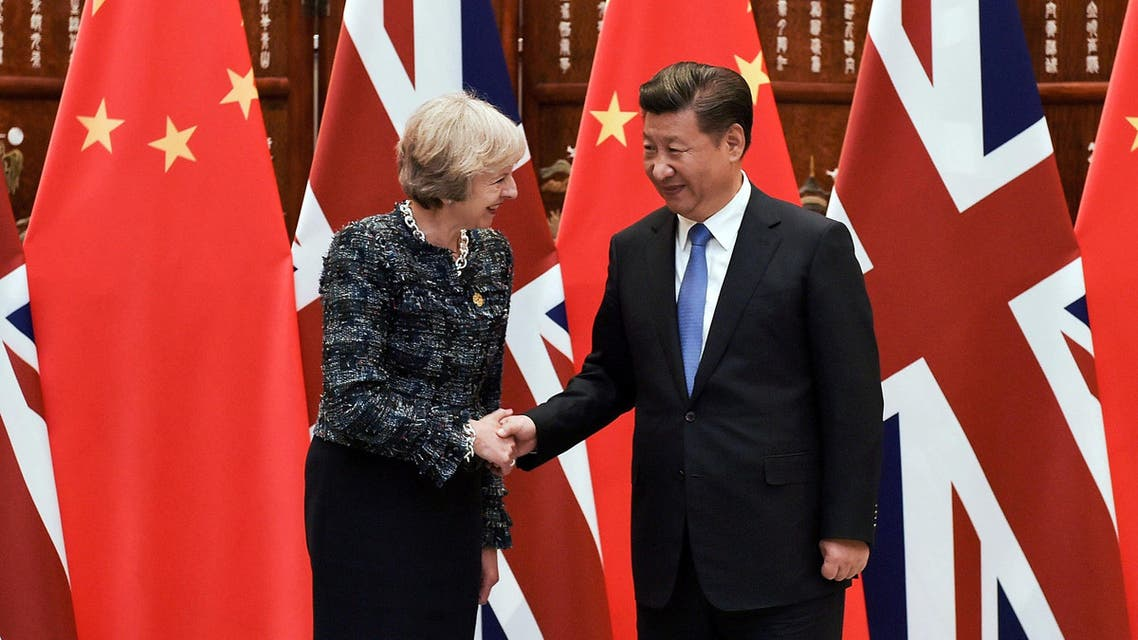 Chinese President Xi Jinping (R) shakes hand with British Prime Minister Theresa May before their meeting at the West Lake State House on the sidelines of the G20 Summit, in Hangzhou, Zhejiang province, China, September 5, 2016. REUTERS
