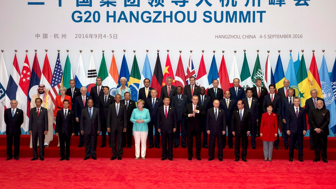 State leaders take part in a group photo session for the G20 Summit held at the Hangzhou International Expo Center in Hangzhou in eastern China on, Sunday, Sept. 4, 2016. (AP)