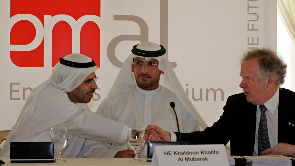 Khaldoon Khalifa Al Mubarak CEO and Managing Director of Mubadala Development (centre) with Abdullah Kalban, CEO of Dubai Aluminium, (left) and Canada's SNC Lavalin CEO, Jacques Lamarre, (right) on during the ground breaking ceremony  of Emirates Aluminium. (File photo: AP)