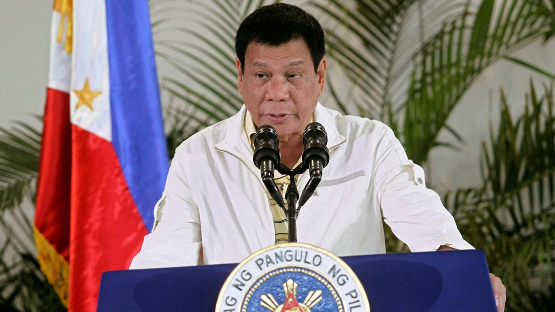 Philippines' President Rodrigo Duterte delivers his pre-departure message before leaving for the Association of Southeast Asian Nations (ASEAN) Summit in Laos at the Davao International Airport in Davao city, Philippines September 5, 2016. REUTERS