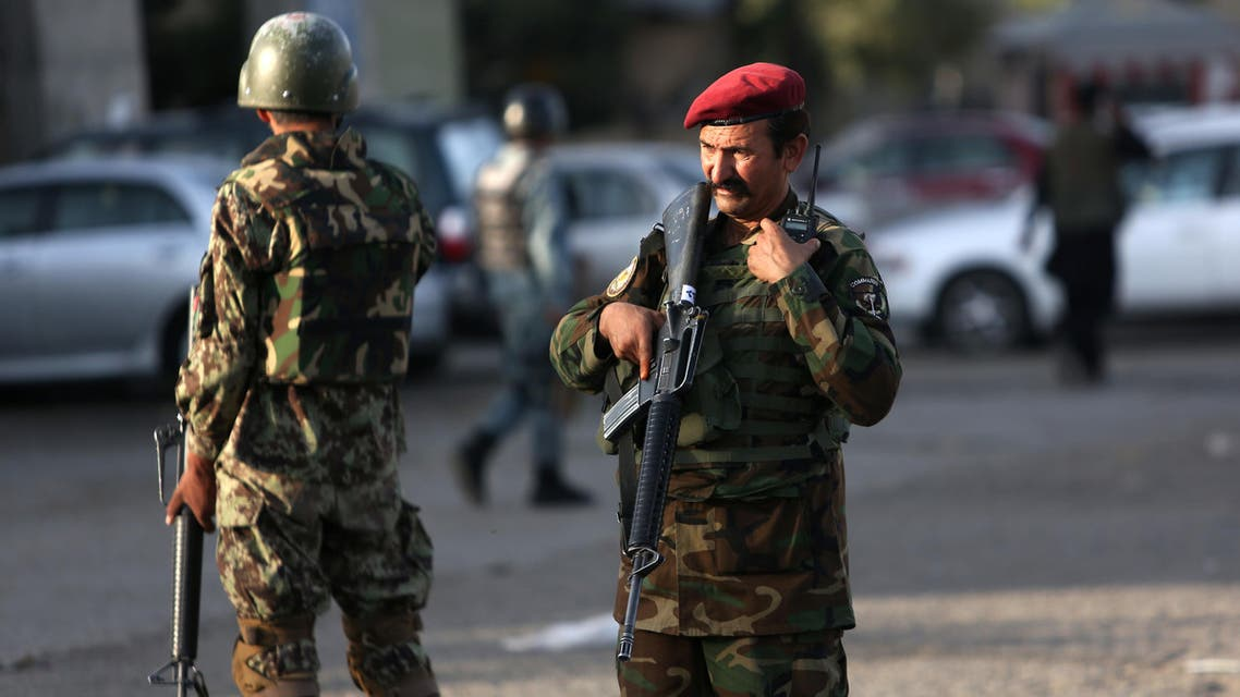 Afghan soldiers inspects the site of suicide attack In Kabul near Afghanistan's Defense Ministry, Monday, Sept. 5, 2016. Twin bombings near the Afghan Defense Ministry have killed dozens of people in an attack claimed by the Taliban. (AP Photo/Rahmat Gul)