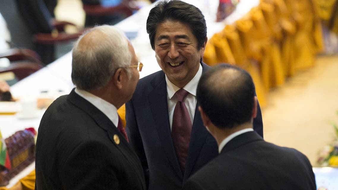 Malaysia's Prime Minister Najib Razak (L) talks with Japanese Prime Minister Shinzo Abe (C) during the ASEAN-Japan Summit in Vientiane on September 7, 2016. The gathering will see the 10 ASEAN members meet by themselves, then with leaders from the US, Japan, South Korea and China. (AFP)