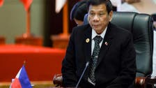 Philippines shows images of Chinese boats at disputed shoal