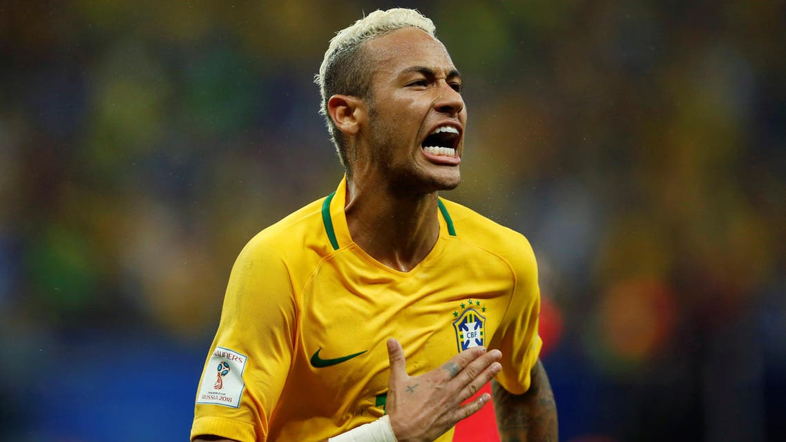 Neymar of Brazil celebrates after scoring a goal against Colombia. (Retuers)